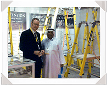 Mike Walsh shaking hands with distributor in Dubai.
