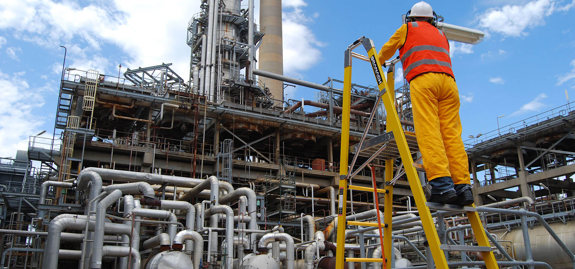 The Branach fibreglass CorrosionMaster 550mm Step Platform Ladder being used in an oil refinery.